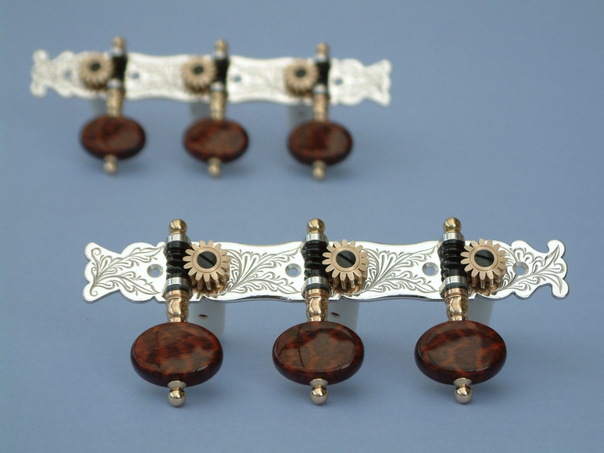L156 Sterling silver and snakewood buttons